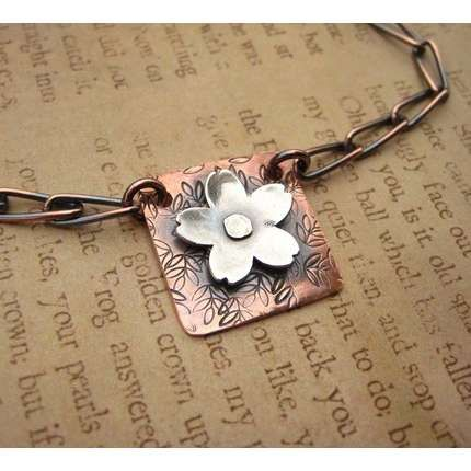 copper and silver flower pendant                                                                                                                                                                                 More