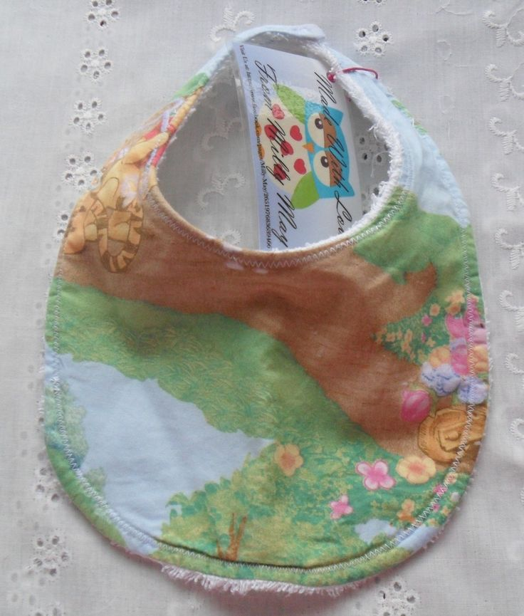 Beautiful Handmade Winnie The Pooh Design Bibs.Made with cotton front and toweling back with snap closure.Make your choice from Bandana style or Traditional Style