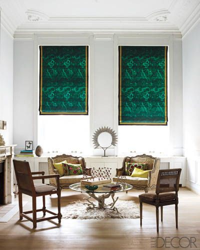 Emerald shades, Mexican ironwork, Marquise-style armchairs, Italian wood chairs, oak floor