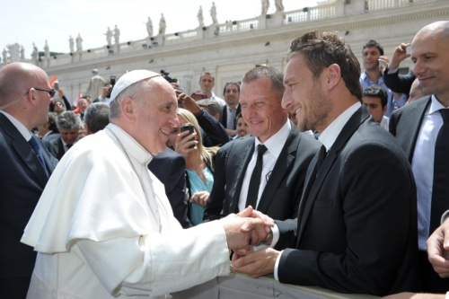 """""""Would you bring a jersey next time?"""". Pope Francis meets AS Romas Totti during weekly audience at Vatican  Pope Francis meets AS Roma soccer player Francesco Totti during the popes weekly audience in St. Peters Square at the Vatican May 22. (CNS photo/ LOsservatore Romano via Reuters)"""