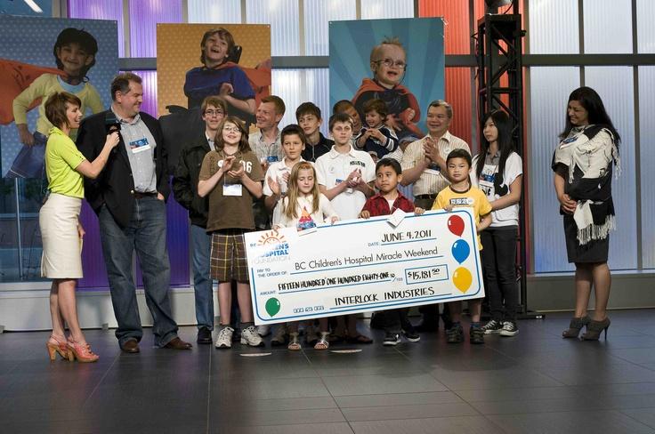 2011 - Interlock Industries (BC) Ltd. donates a check to the BC Children's Hospital Foundation.