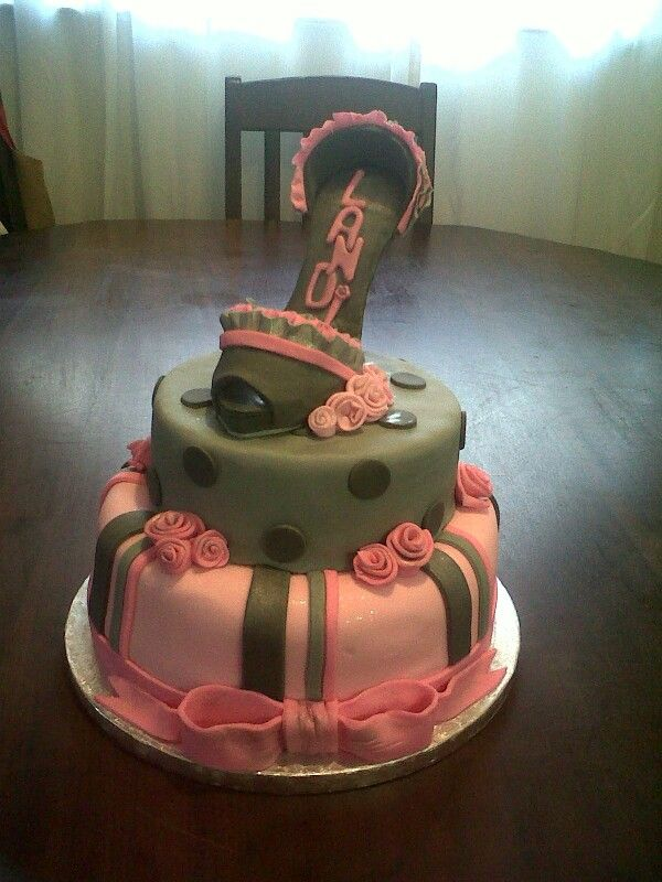 A very girly pink and grey stiletto cake. www.koekeloercakes.co.za