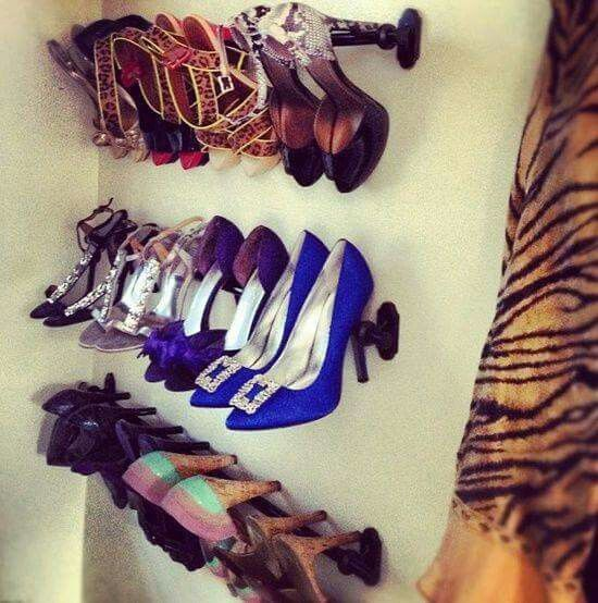 This is pretty inventive. Use curtain rods to make wall hanging shoe racks.