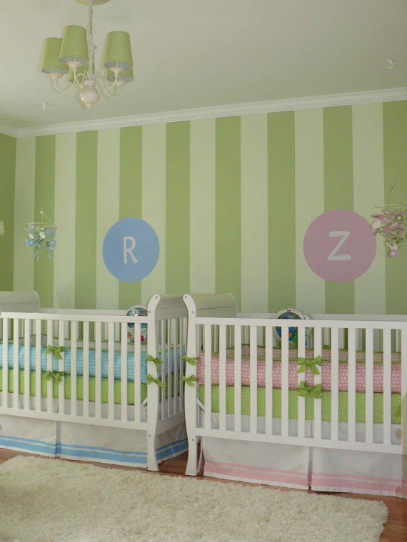twins cribs - not sure about the striped wall but I like how the two cribs are for a boy and girl.