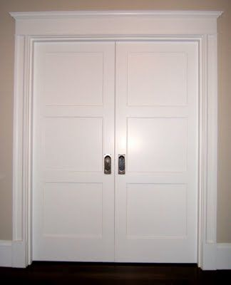 Put it all together on a pair of pocket doors and you get a picture of perfection.  The interior doors are T.M. Cobb F-30 3-panels in fir.  Simpson has a similar door here.  Check back for trim details at the stairs, crown moulding, and box beams.