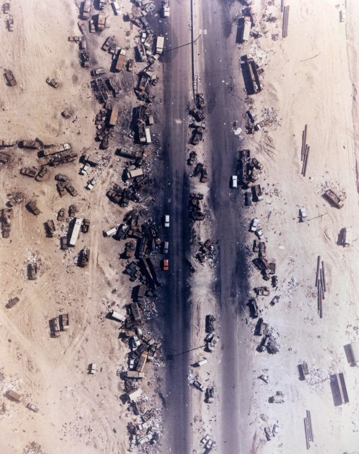 """Highway of Death, The result of American forces bombing retreating Iraqi forces, Kuwait, 1991. Iraqi tanks, armored vehicles, trucks and troops fleeing the allied onslaught formed huge queues on the main road north from Kuwait to the southern Iraqi city of Basra. Allied forces bombed them from the air, killing hundreds of troops in their vehicles in what became known as the """"Highway of Death"""". The scenes of devastation on the road are some of the most recognizable images of the war."""