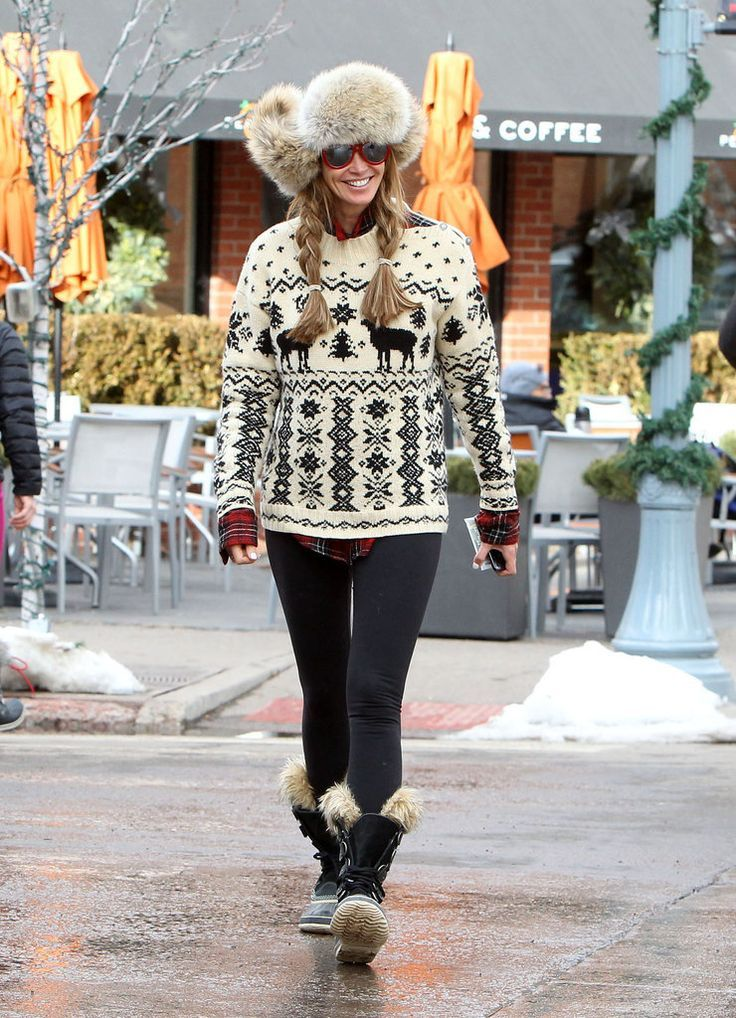 what to wear skiing, apres ski outfit, winter outfit, ski vacation, winter outfit, snow outfit, elle macpherson, fair isle ski sweater, fur hat, sorrel boots, fur boots, leggings, plaid flannel shirt