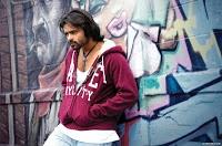 Sai Dharam Teja in Rey Movie Stills,Megastar Chiranjeevi nephew Sai Dharam Tej stylish look stills in Rey Movie,Directed by YVS Chowdary