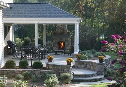 patio designs for outdoor fireplaces . . . bricks and stones