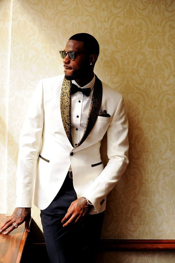 Hometown NBA Star marries in Louisville in a lavish wedding. This dapper groom enjoys a brief hint of sunlight in his white dinner jacket with black and gold lapels.