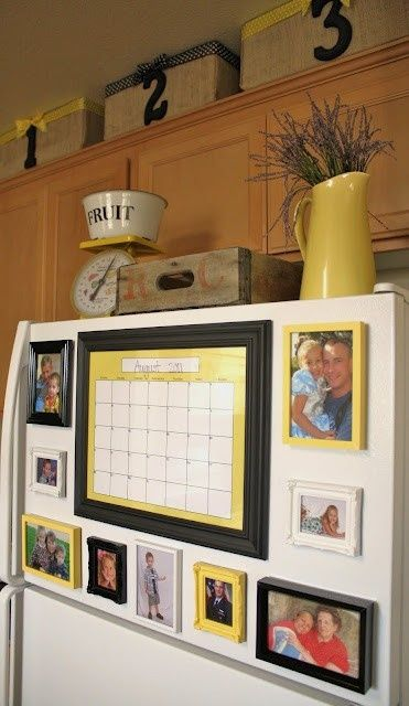Looks much better than pictures hanging w/ magnets - use dollar store frames, paint them and put magnets on the back. Love the calendar idea.
