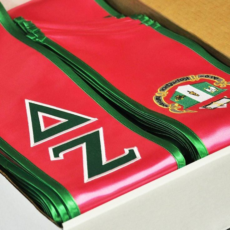 A box full of beautiful Delta Zeta graduation stoles ready to ship out! Order your graduation stole today from customsash.com @customsash.