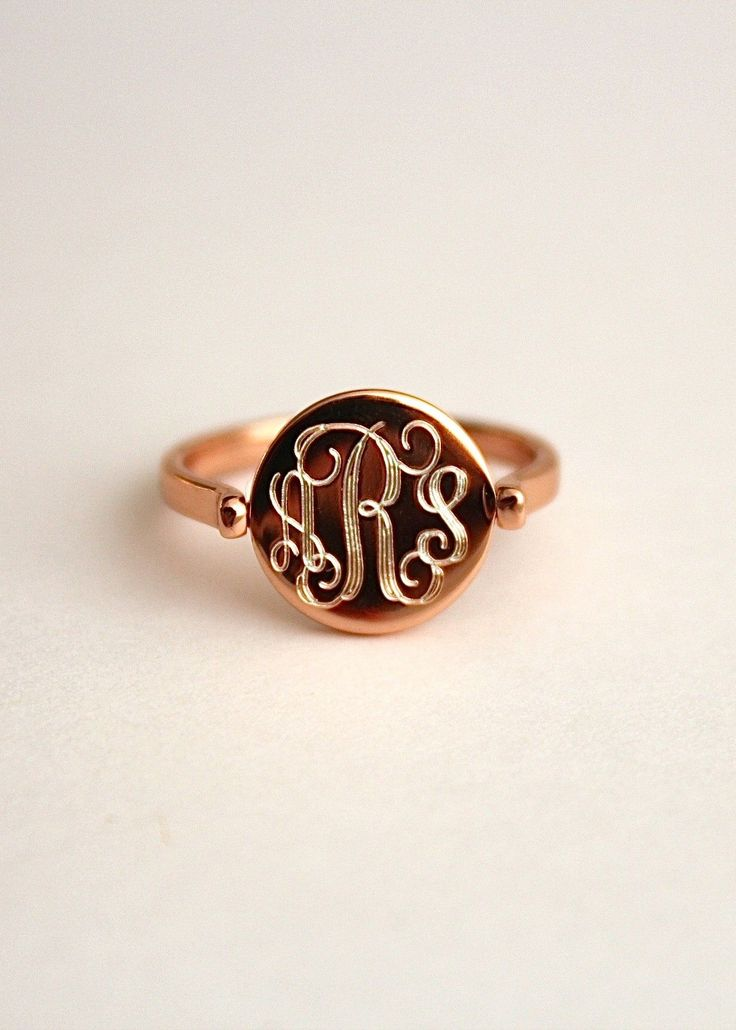 The most seductive monogrammed piece, you'll be in love with this lustrous sterling silver ring with a thick plating of rose gold.  When engraved by our local craftsman, the sterling peeks through the rose gold for the most stunning effect.  Ring may be further customized and may be engraved with a short sentiment on the back side.  The disc can flip so either side may be worn on the front!   Please note, This is a limited edition piece and we only cast this ring in size 7 for now…