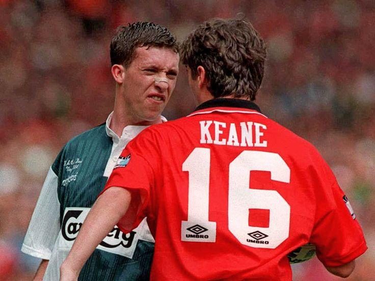 Roy Keane & Robbie Fowler exchange words.