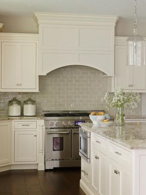 See the beautiful neutral subway tile backsplash in this kitchen with a built-in range hood on HGTV.com.