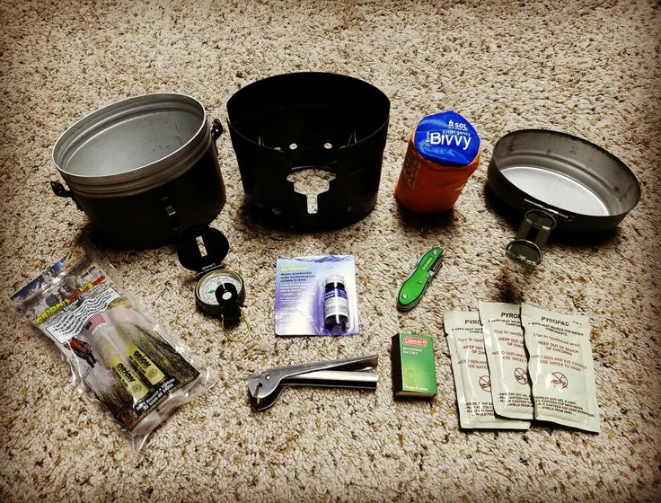 Military surplus camp stove and bare survival essentials. Emergency Bivy, Water purification, Fire Starters and fuel, multi tool, and a compass. All of it neatly packs in the stove to save space in the full bug out bag.