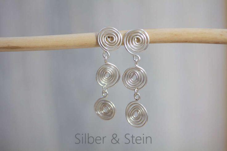 Lange Silber-Ohrringe mit Spiralen