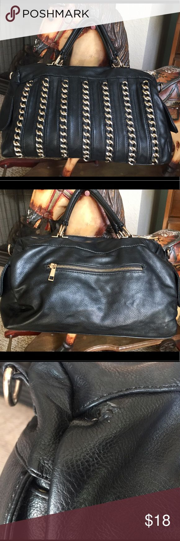 Cute purse by MMS Black purse with gold hardware. Has one zippered compartment in the side and 2 pockets on the side that closes with magnetic push buttons. Little cut on the back, see picture and the zipper in the inside compartment is broken. Priced accordingly. Bags