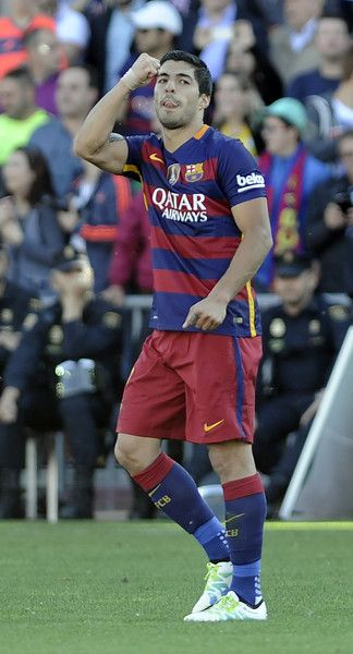 Barcelona's Barcelona's Uruguayan forward Luis Suarez celebrates their 24th La Liga title at the end of the Spanish league football match Granada CF vs FC Barcelona at Nuevo Los Carmenes stadium in Granada on May 14, 2016. Barcelona sealed their 24th La Liga title as Luis Suarez took his tally for the season to 59 goals with a hat-trick in a 3-0 win at Granada to hold off Real Madrid's late-season surge.