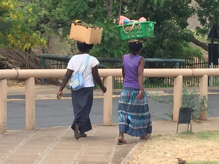 Amazed by how they could carry so much on their heads in Victoria Falls Zimbabwe
