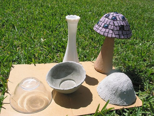 How to make a mosaic mushroom ~ This type was made over a glass bowl (covered in plastic wrap), with the concrete over it. (Hypertufa would be lighter weight)  The stem is a bud vase with the concrete mix over it.