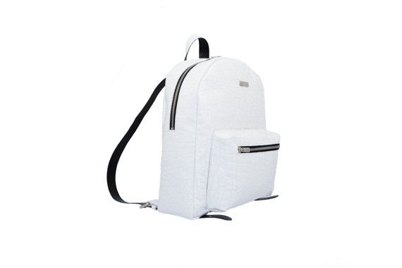 Make a statement in your off-duty repertoire with this white leather backpack from MONAO. Crafted with white patent structural leather catches all