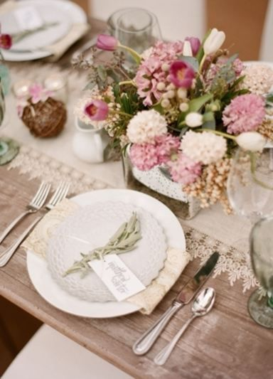 A Gorgeous Table Set With Blush And Pink Flowers