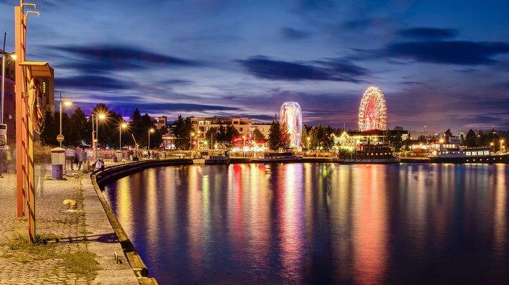 Funfair and reflections at passenger harbour of Kuopio