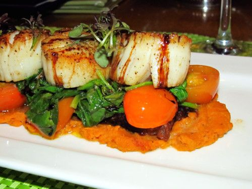 Seared Digby scallops on a layer of Oulton's bacon, tomatoes, spinach, and for an extra tasty treat, butternut squash and pumpkin purée  Saege Bistro  Halifax, Nova Scotia