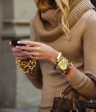 the item to notice is the watch, it works with opulent gold layering and a camel brown colored roll neck sweater.