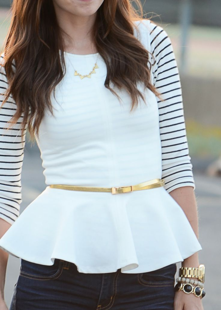 I like how she layers the striped underneath.