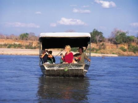 Boat Safari in  Selous Game  Reserve (Tanzania). 'A highlight of a visit to  the vast Selous Game  Reserve is floating  along the Rufiji River on a  boat safari. As you glide past  borassus palms, slumbering  hippos and cavorting  elephants, don't forget to  watch also for the many  smaller attractions along the  river banks.' http://www.lonelyplanet.com/tanzania/sights/outdoors/selous-game-reserve