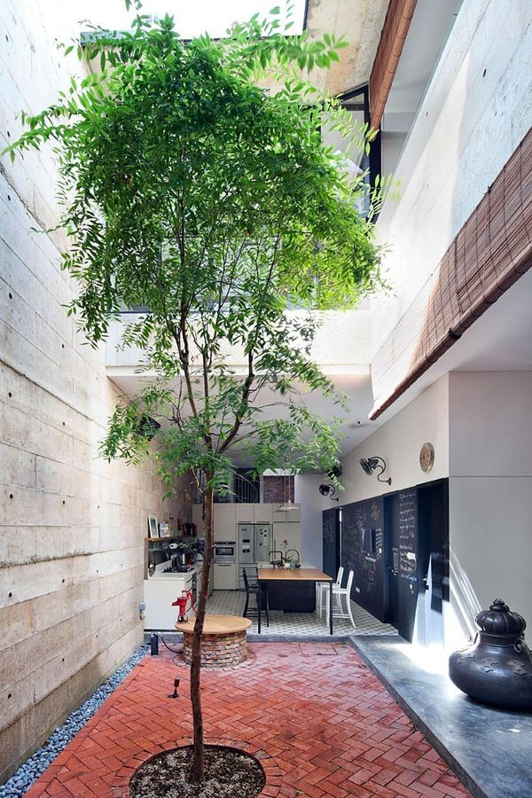 Less trees + water, more hardscape // Redesign of a charming Peranakan shophouse in Singapore