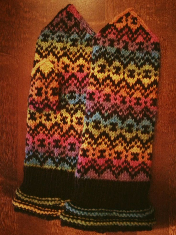 Black and rainbowcolored yarn make these mittens special