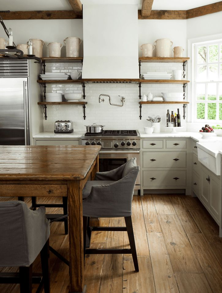 "A trend you'll be seeing a lot more of - and not just on ""Fixer Upper"" or in Country Living - what some are calling the ""un-kitchen."" Kitchens with cabinets that are/look like pieces of furniture, open shelving replacing closed wall cabinets, and lots of industrial-look plumbing and lighting fixtures. Love it or hate it?"