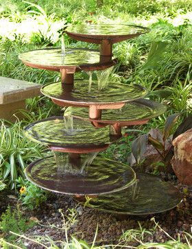 Home & Garden $2,800.00	 Dripping Springss dishes seem to float in space, the water rising magically and falling musically, reflecting the beauty around it. Product Specifications: Sold By:Kevin Caron Studios | Visit Store » Category:Outdoor Fountains Style:Eclectic Location:Phoenix