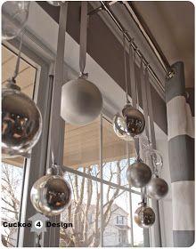 STIJLIDEE Kerststyling DIY Tips >> Hang je meest bijzondere kerstballen aan een mooi lint voor je raam via http://cuckoo4design.blogspot.com/2012/11/christmas-coffee-table-decor.html?m=1