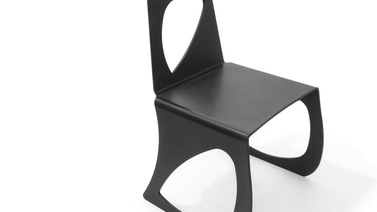 Minimal and functional, super hero chair is a stackable chair.