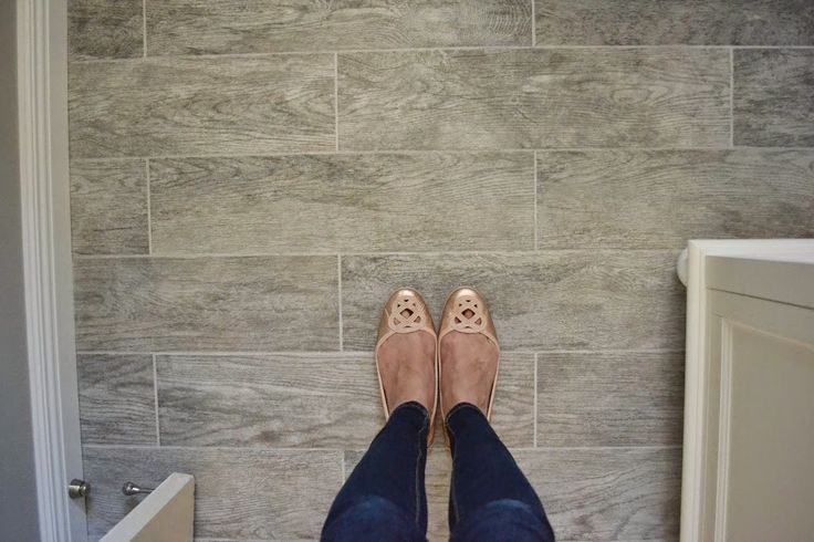 Get the look on a budget! This post breaks down all the materials used to get a very finished looking bathroom with the gray wood look tile that's so in now without breaking the bank. How I renovated our bathroom on a budget - Hello Splendid