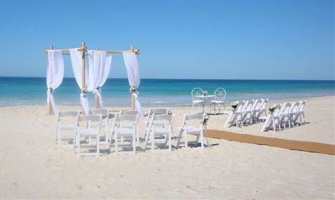 Beach ceremony setup by JVK Floral Designs Dunsborough