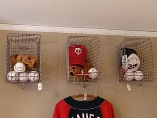 Basket displays with Sports Stuff in it! Simple and Great Idea! When I change their room to a baseball theme :)