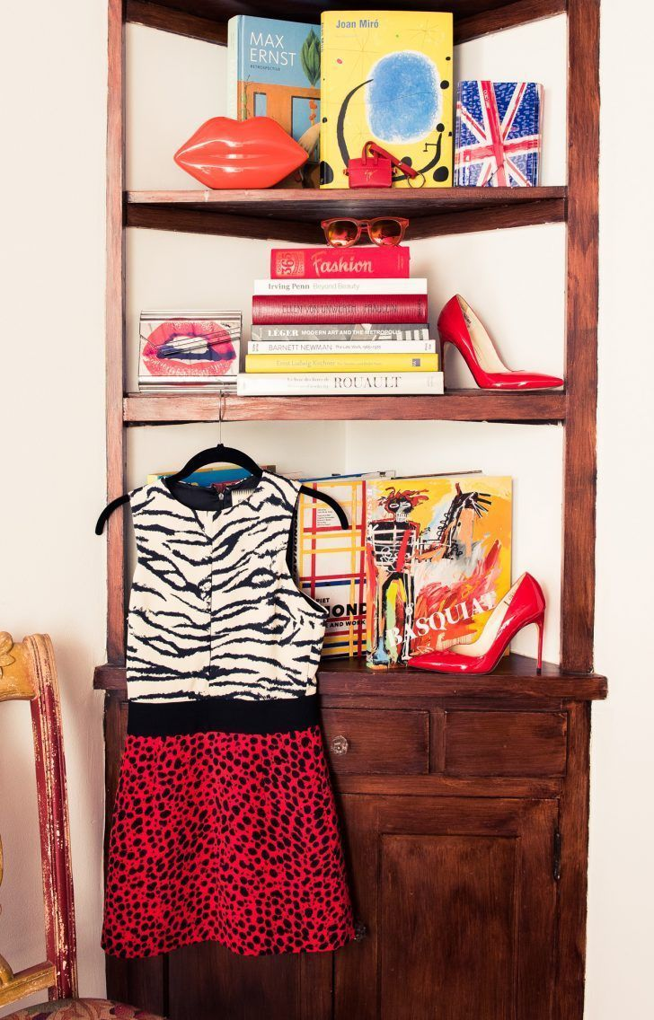 Inside Fashion Stylist Sophie Lopez's Closet: Lips Bag and British Flag Bag by Lulu Guiness, Giuseppe Zanotti, and Jimmy Choo, Black, White and Red Animal Print Dress by Fausto Puglisi, Red Pointy Toe High Heels by Brian Atwood | coveteur.com #brianatwoodheelsdresses