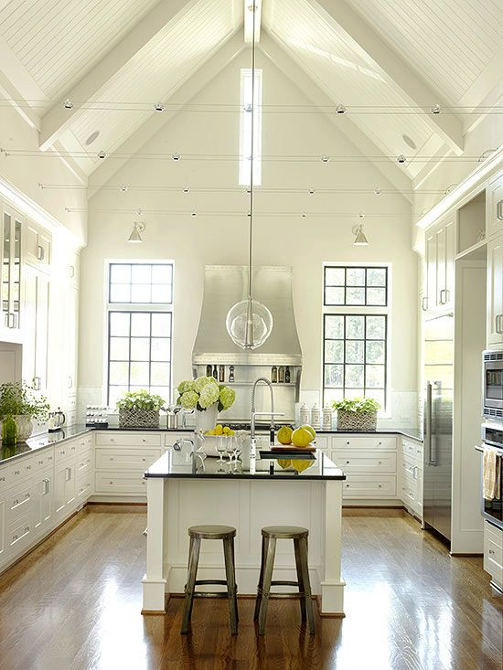 A vaulted ceiling and bead board reinforce the country-meets-cottage-meets-contemporary feel of this bright kitchen.