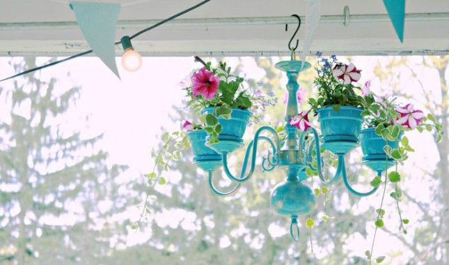 Vintage chandeliers + flower pots = seriously gorgeous planters.