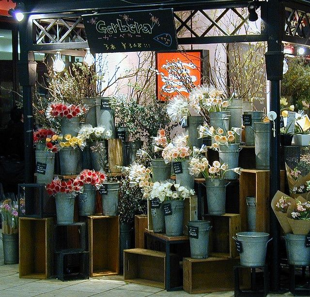 Flower shop at Shibuya Station - metal buckets and chalkboard signs