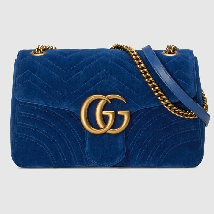 11ca2d36601 Shop the GG Marmont medium velvet shoulder bag by Gucci. The medium GG  Marmont chain shoulder bag has a softly structured shape and an oversized  flap ...