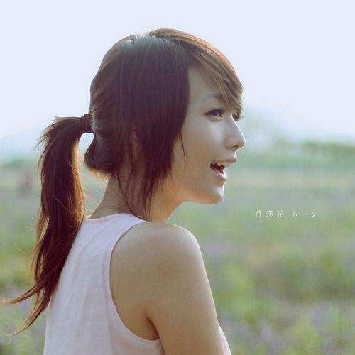 Cute Asian hair, long natural color with  layered bangs, up-do.