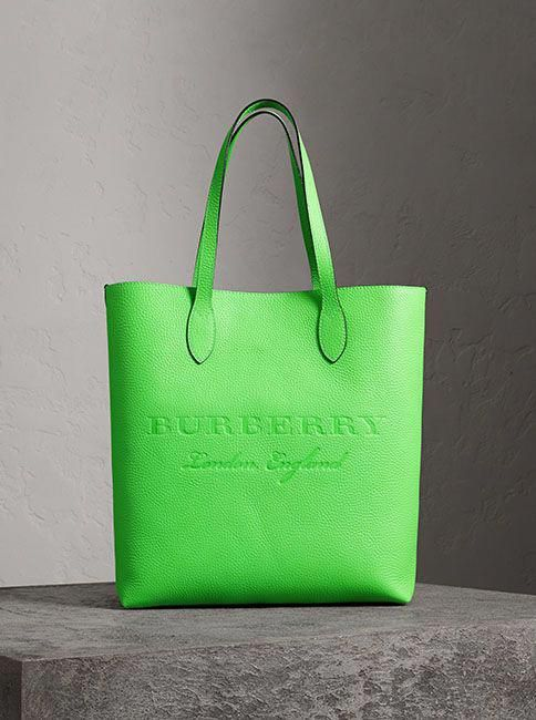 2cdc9186417 A versatile leather tote by Burberry in a vibrant neon hue with an interior  zip pocket