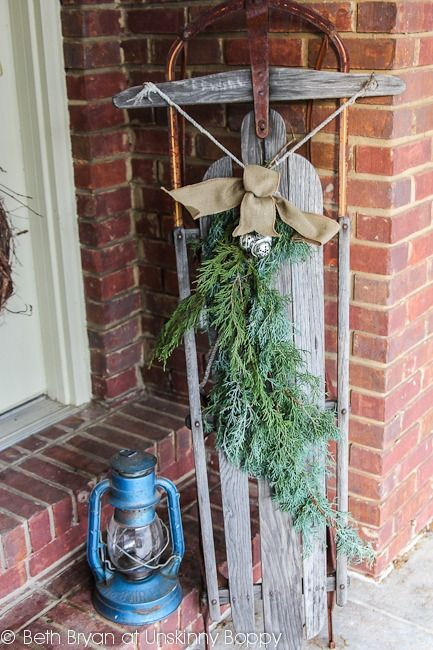 Porch Decorating Ideas - old sled and blue lantern
