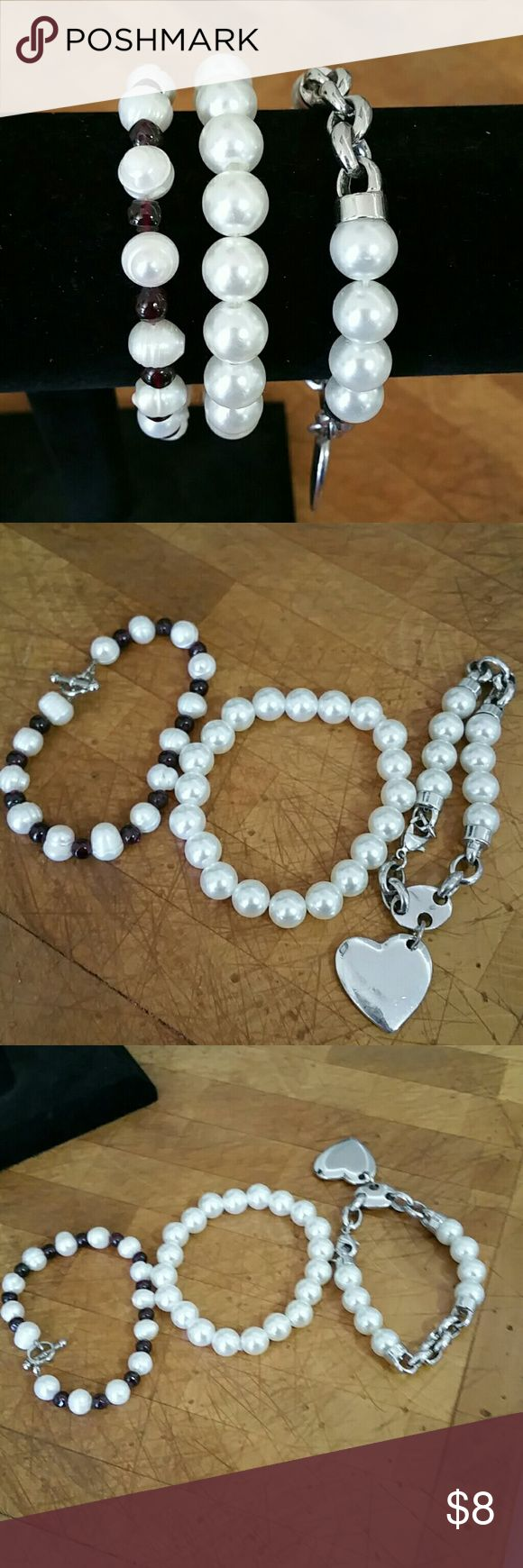 LADIES PEARL BRACELETS. LADIES  PEARL BRACELETS, 1 HAS HEART PENDANT,  1 HAS DARK STONES BETWEEN PEARLS,  ONE SIZE, 2 HAS CLOSURES ONE STRETCHES. PEARLS Jewelry Bracelets